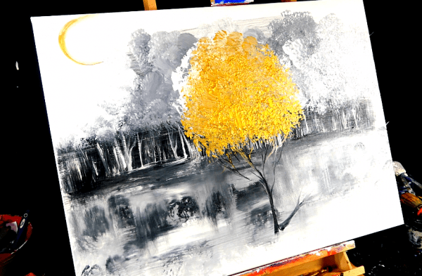 Painting beautiful gold tree in the middle of black and white forest on large canvas