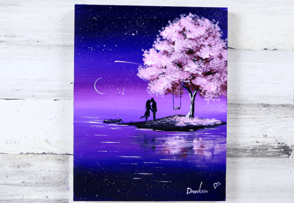 couple in love under blossom cherry tree